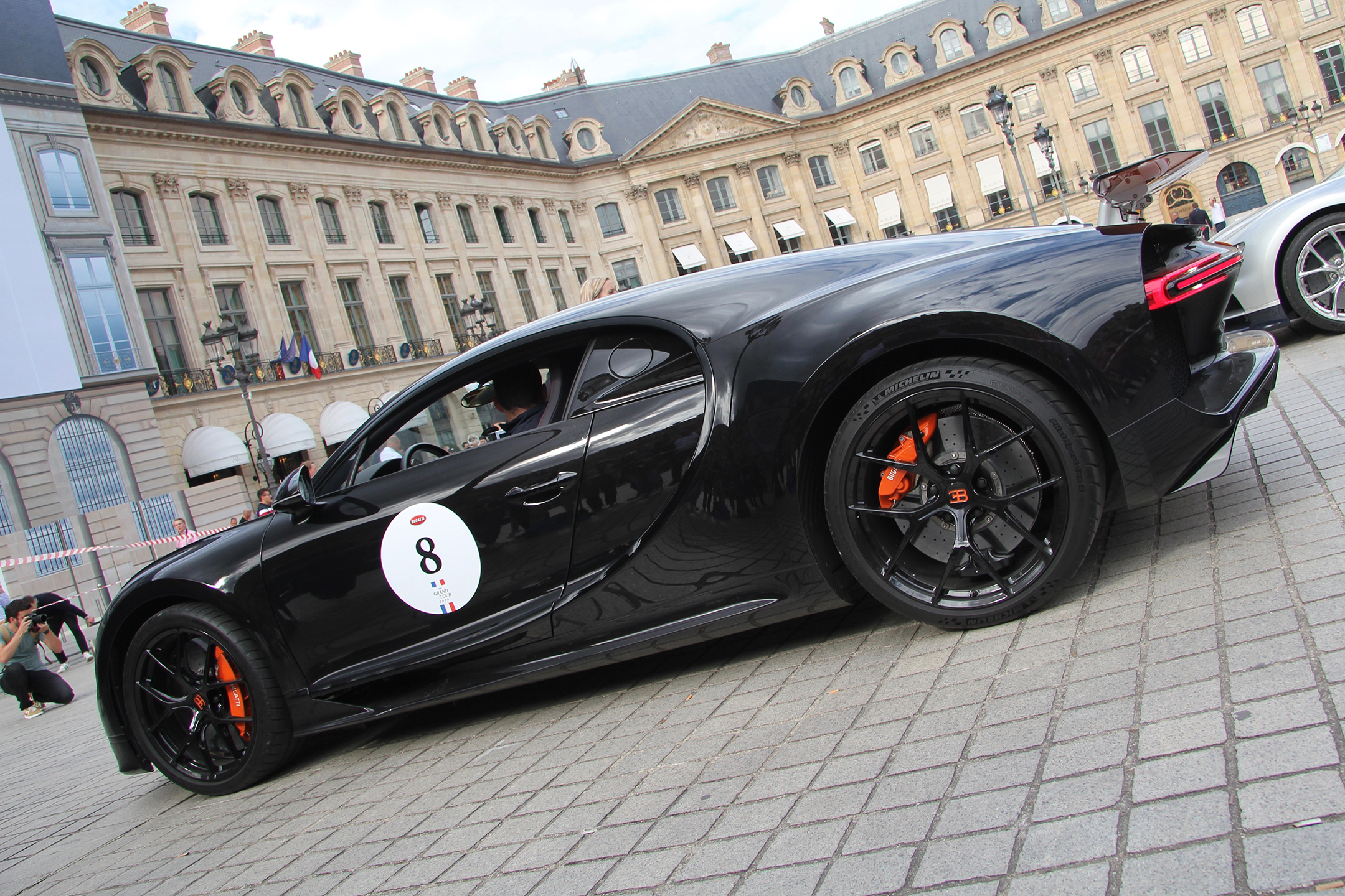 Bugatti Automobiles - black livery orange accent - Chiron - W16 - Grand Tour 2019 - Paris - photo Ludo Ferrari